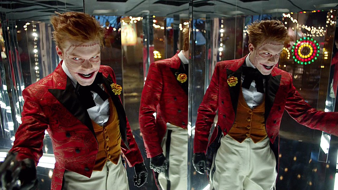 The joker standing in a hall of mirrors.
