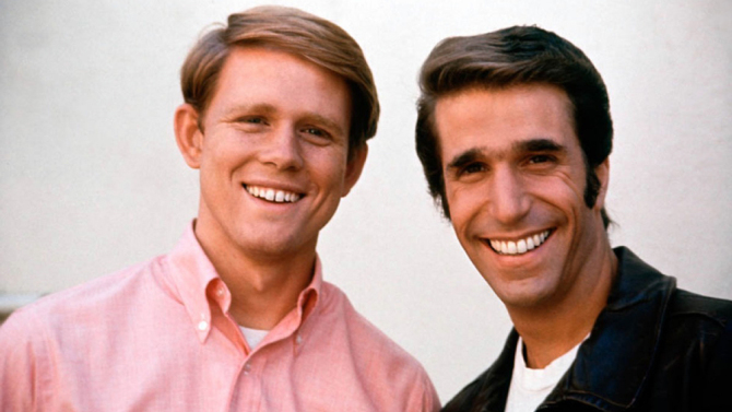 Ron Howard and Henry Winkler posing together on the set of Happy Days.