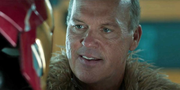Michael Keaton as Vulture looking at an Iron-Man mask.