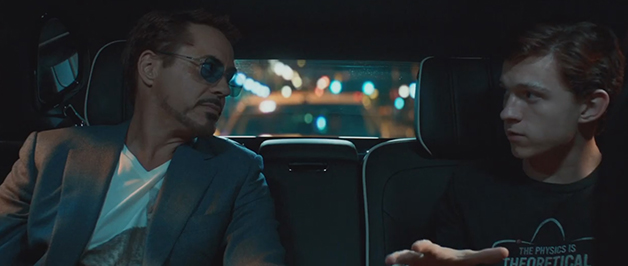 Peter Parker and Tony Stark looking at each other in the back seat of a car.