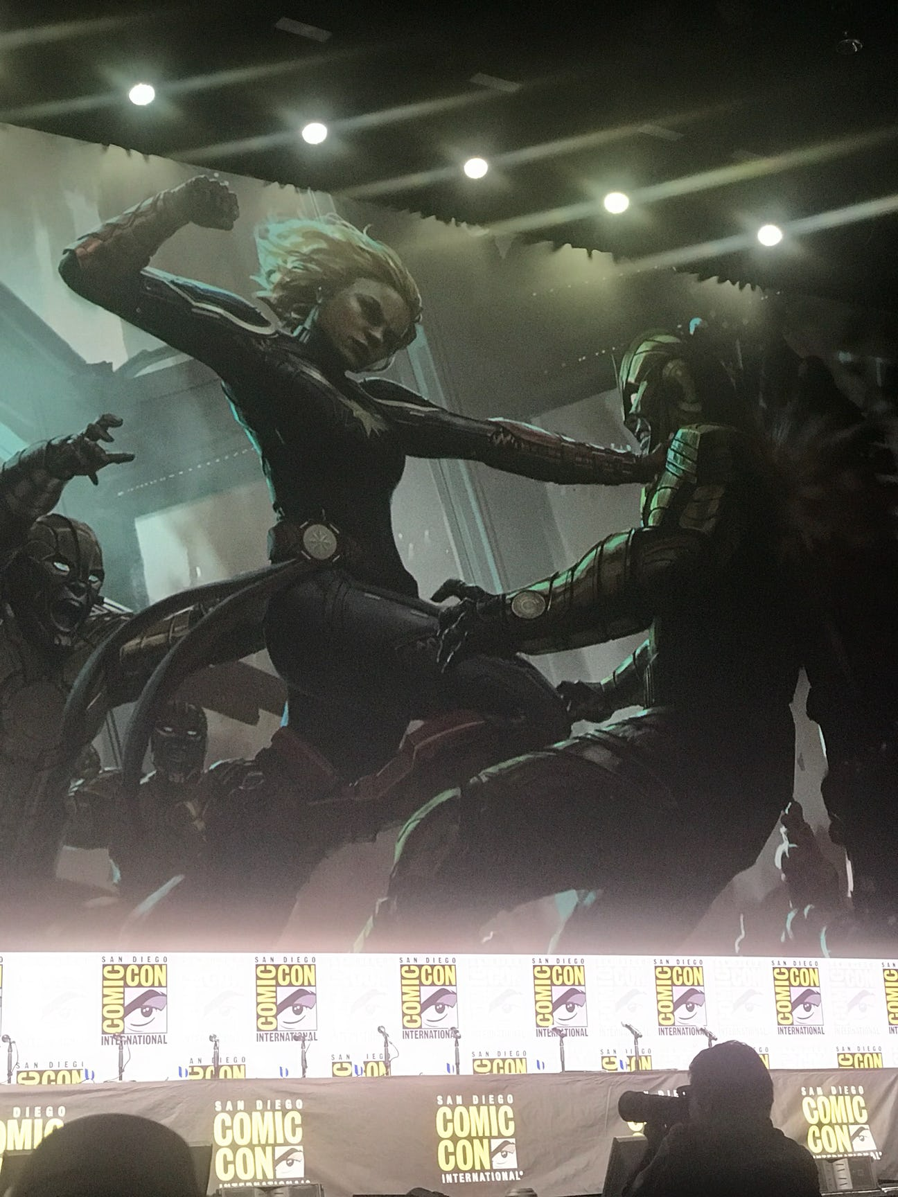 Captain Marvel concept art of her fighting someone in armor.
