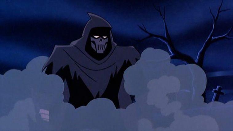 The Phantasm standing in smoke in a graveyard.