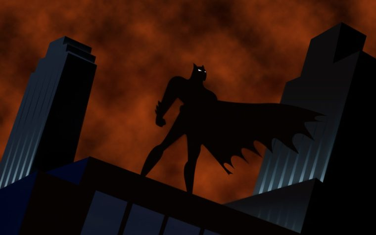 Batman in silhouette standing on a building from Batman the Animated Series.