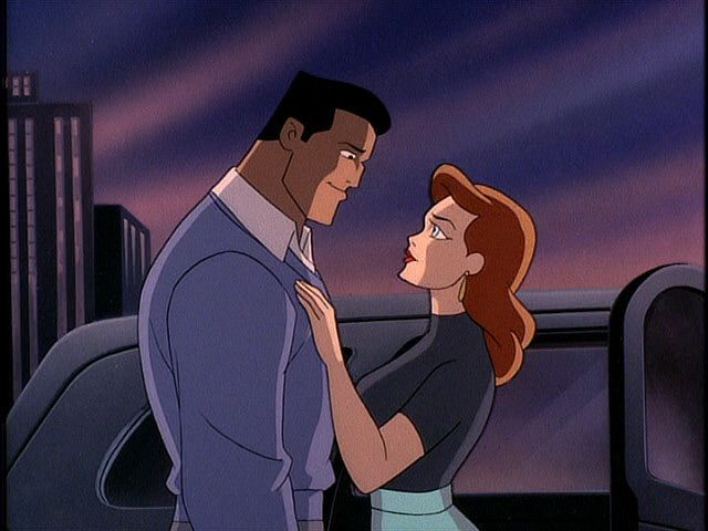 Bruce Wayne with a woman looking as if they're about to kiss.