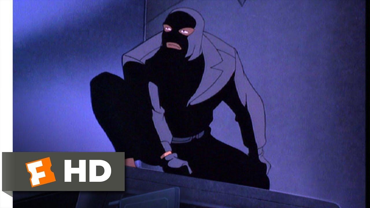 A masked man crouching in the dark.