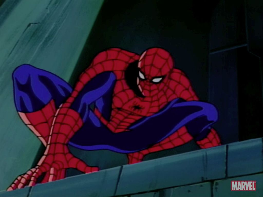 Spider-Man crouching on a building ledge looking down, from the Spider-Man animated series.